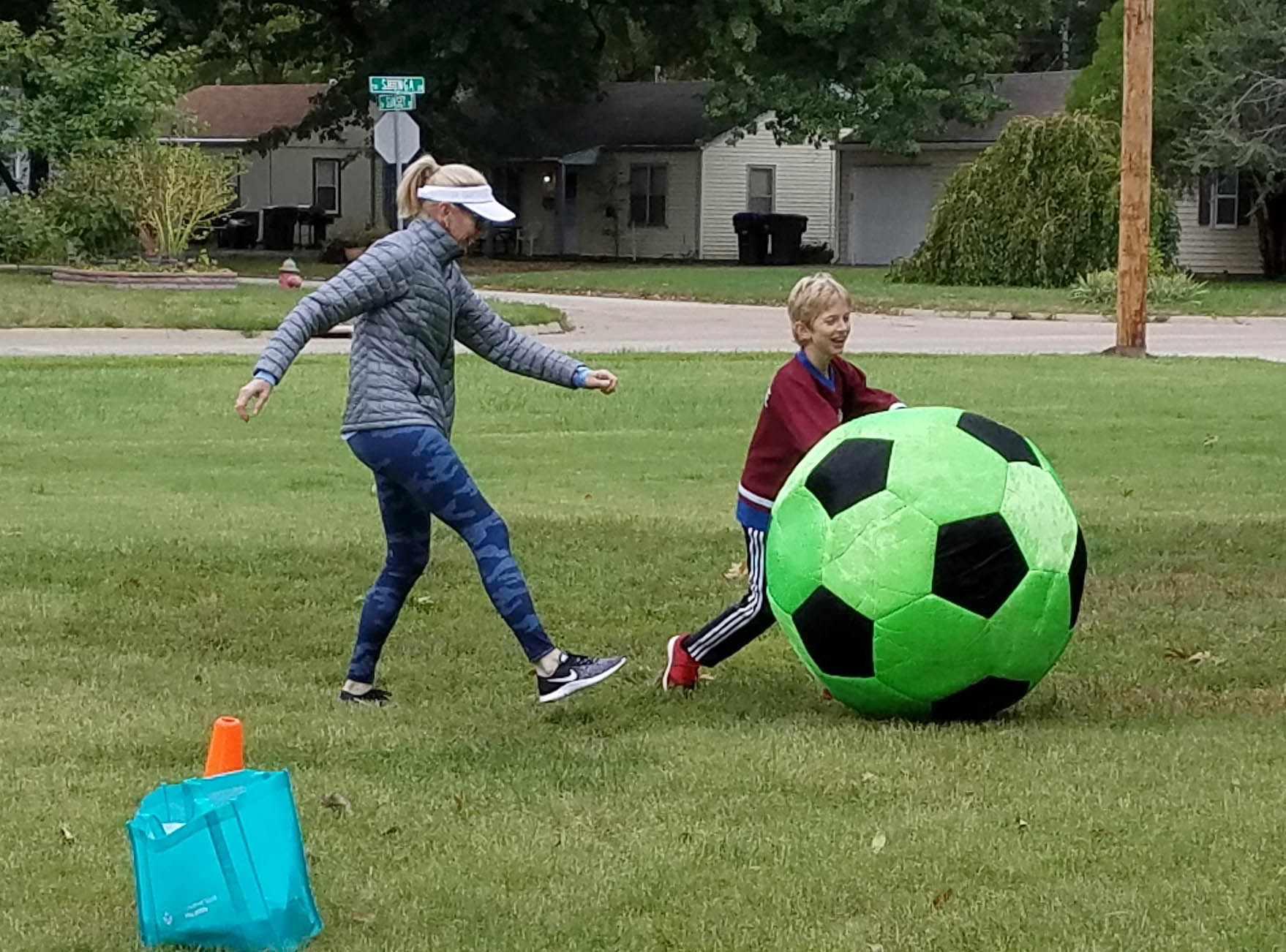 Mom and son playing Giant Soccer Ball