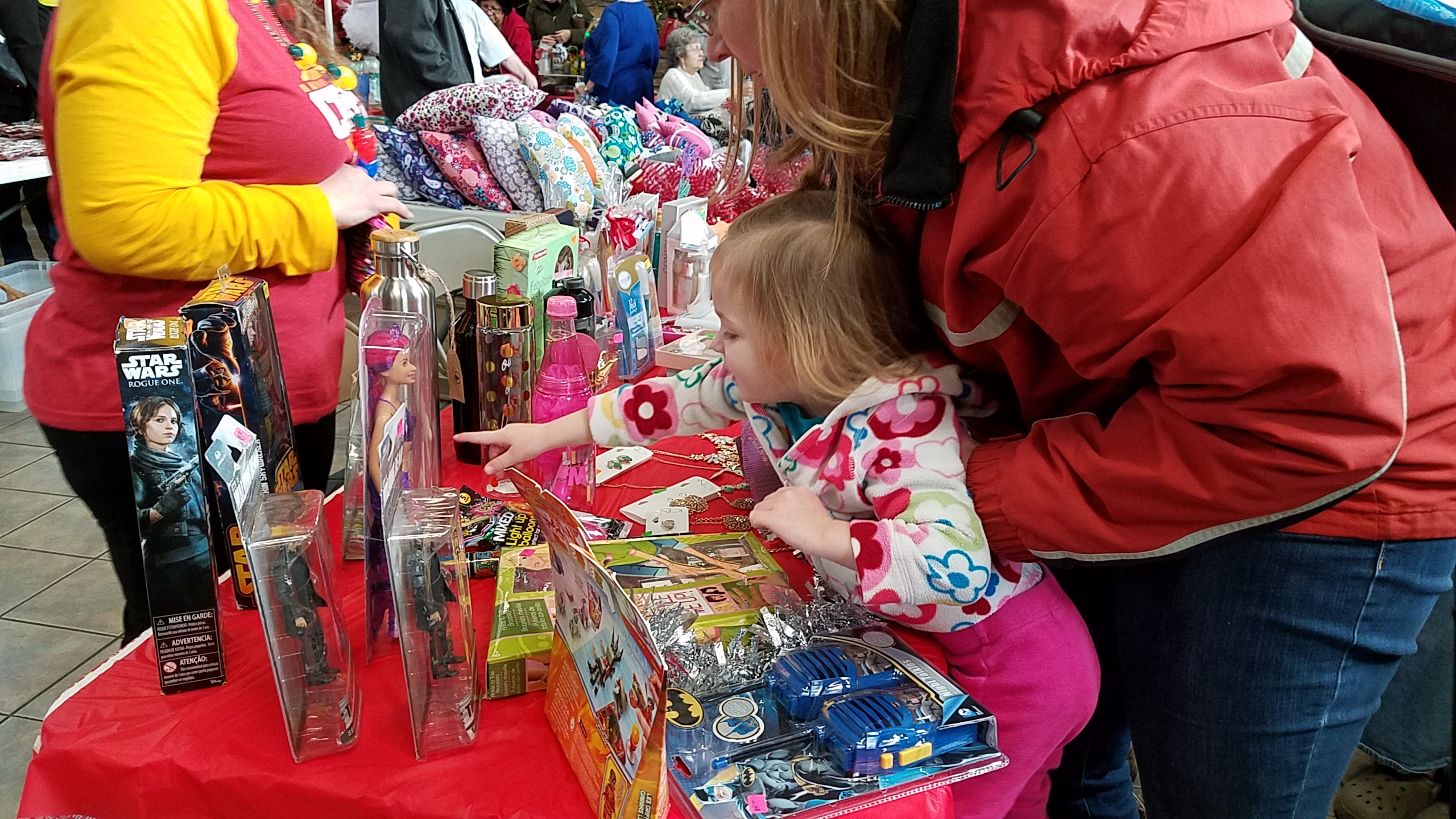 Little girl choosing gift