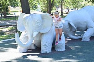 Little girl on Animaland elephants