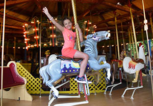 Young girl on a Merry-go-round horse