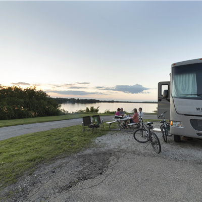 Campers with RV and bikes at Lake Shawnee Campground