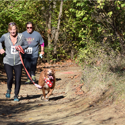 Ladies w dog in bandana running trail