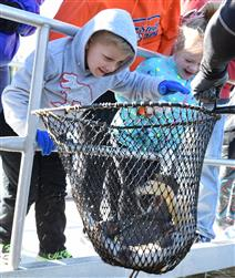 Kids touching fish in net for web.jpg