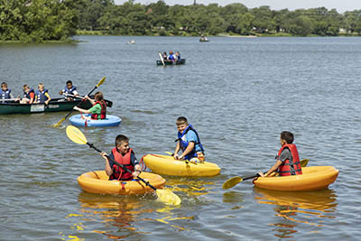 Boys in Corcl boats in Lake Shawnee