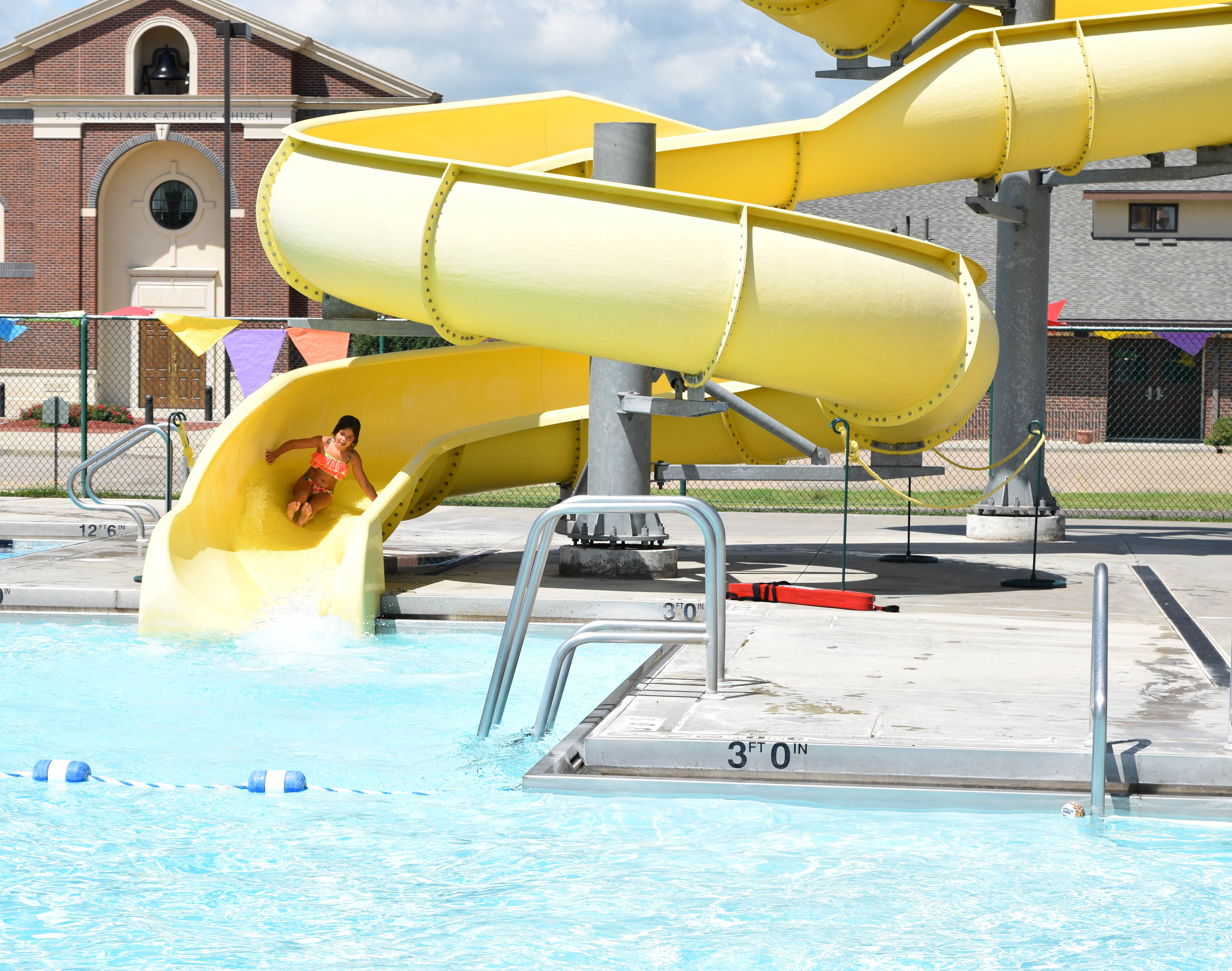 Girl on waterslide at Rossville Community Pool